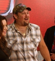 Larry the Cable Guy walks the red carpet at the CARS premiere.
