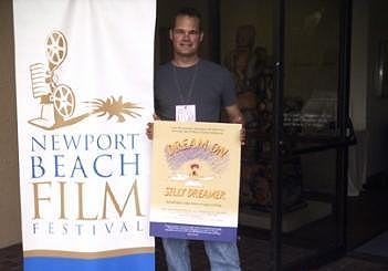 DREAMER director Dan Lund holds the poster for his documentary, at the Newport Beach Film Festival.