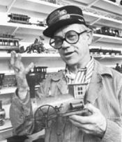 Animator Ward Kimball expresses interest in his train collection.