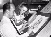Beaumont beholds Marc Davis drawing Alice, in the PAN Platinum Edition feature 'You Can Fly: The Making of PETER PAN.'